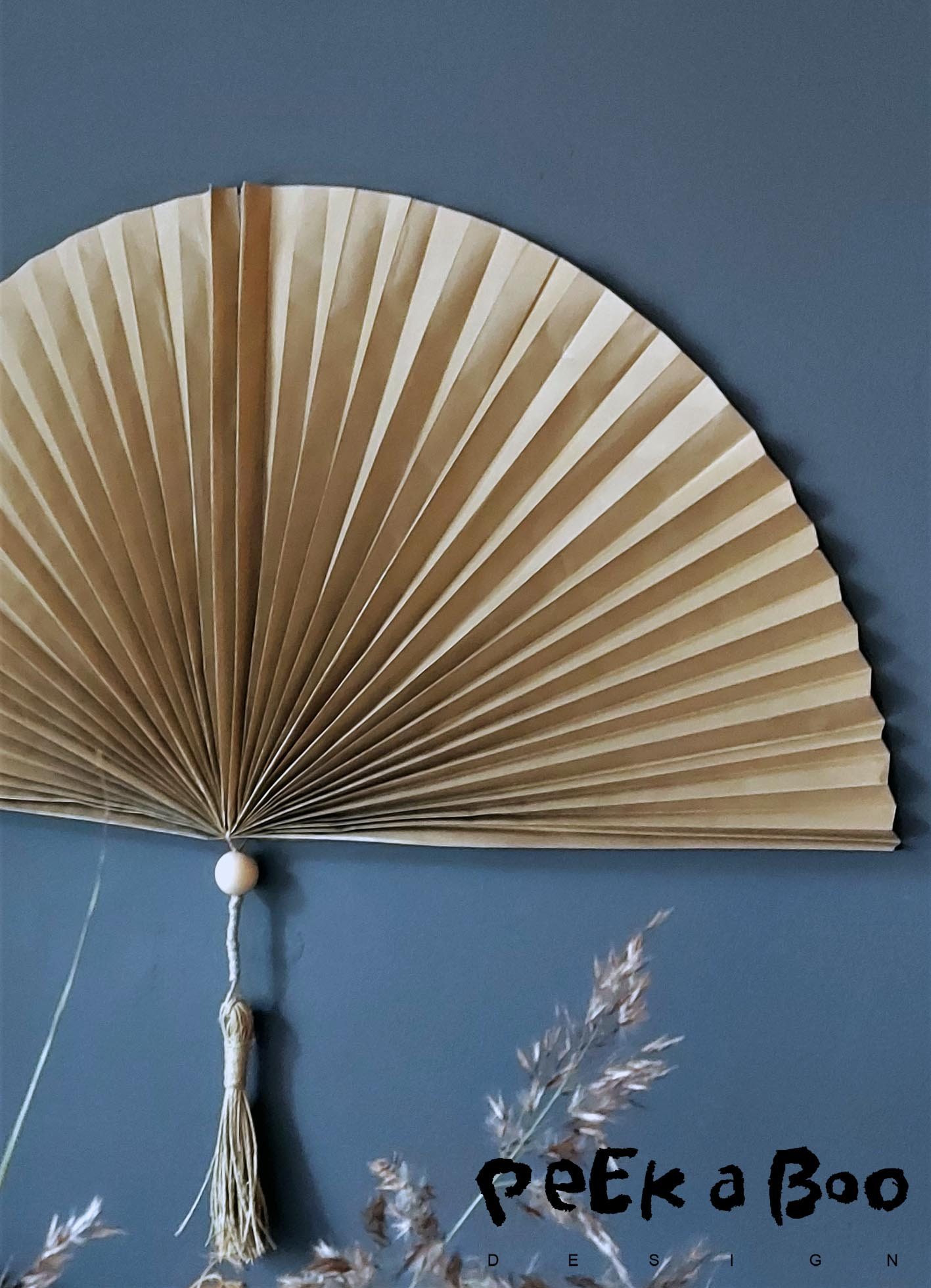 The pretty DIY fan made of brown wrapping paper.