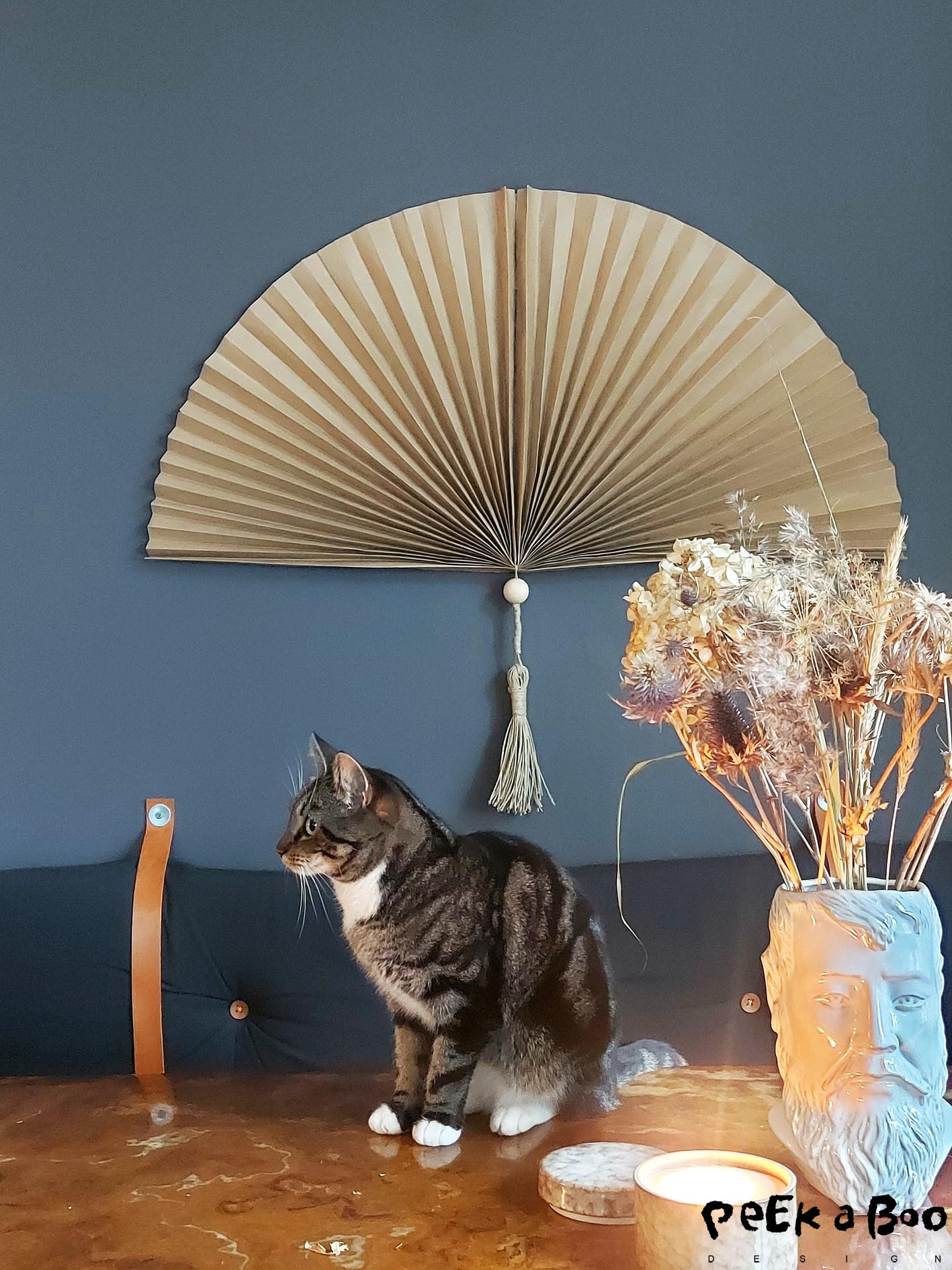 Make this exclusive looking paper fan from ordinary brown wrapping paper.
