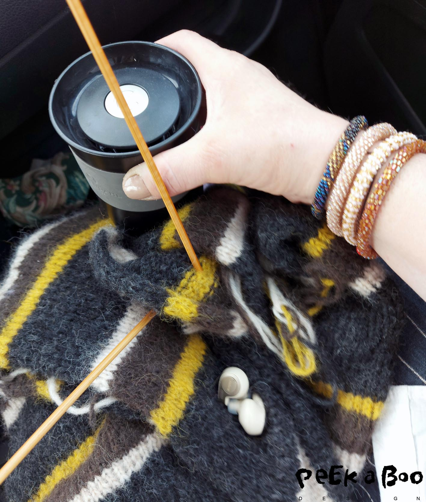 On the go with headset, tea and knitwear....what's not to like ???