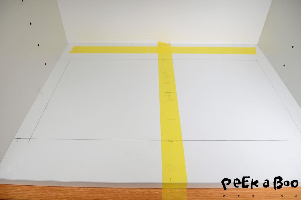 Mark up where you have to cut out for the extractor hood.