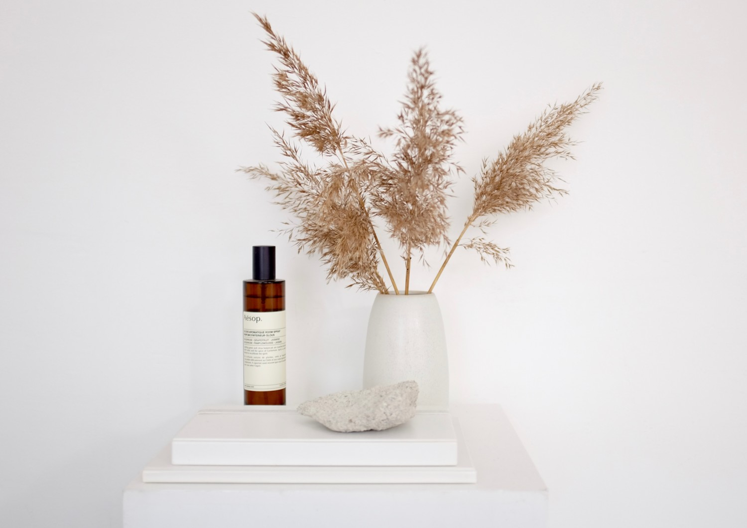 Plinth - a pedestal I use to exhibit some of my favourite interior objects. Here Aesop roomspray and a ceramic vase with dried pampas grass