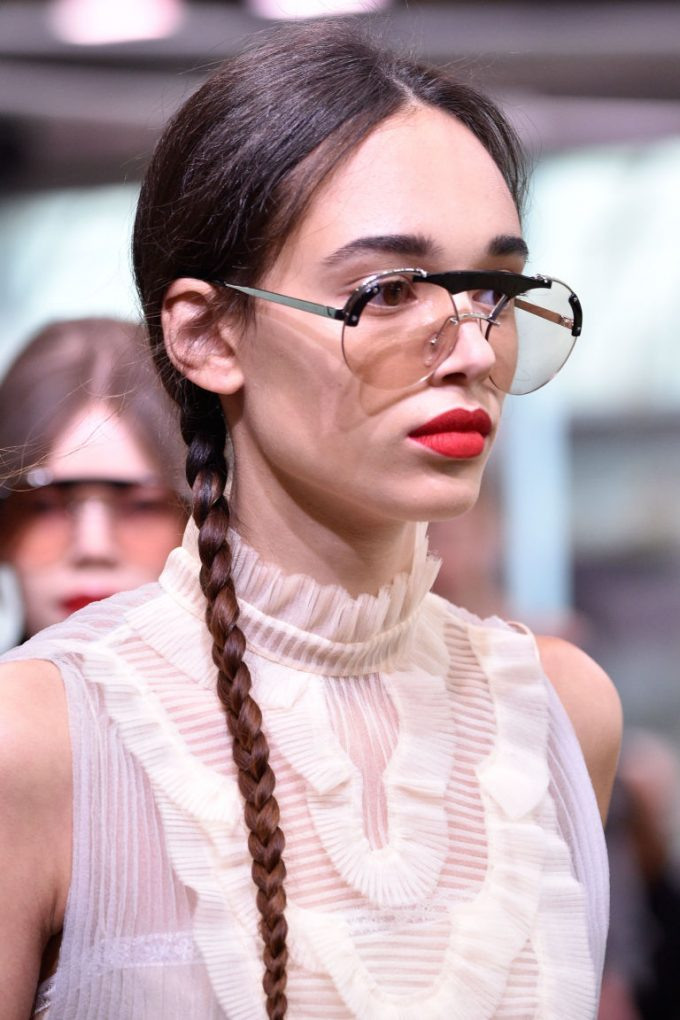 gallery-1494246739-prada-resort-2018-pigtail-plaits-and-red-lips