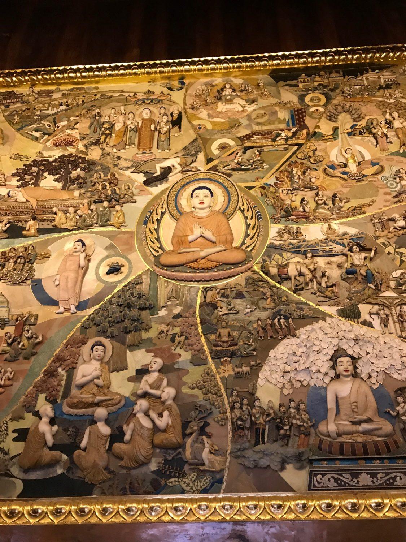 Et buddhistisk maleri som igen var udhugget.