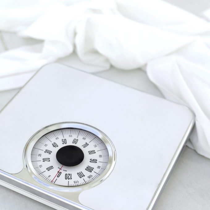 Fasthold vægttab Weighing Scales Image by Royalty-Free Corbis