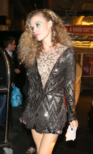 Georgia May Jagger in a short cocktail dress of style 1980s