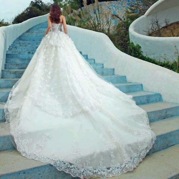 robe de mariée des Poissons longue blanche en dentelle