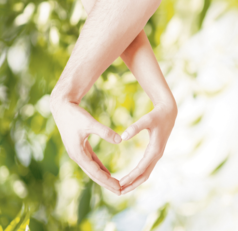 eco, bio, nature, love, harmony concept - woman and man hands showing heart shape
