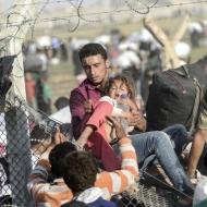 9300665-turkey-syria-conflict-refugees-border