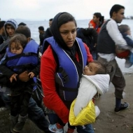 Afghan immigrants land at a beach on the Greek island of Kos